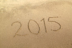 Year 2015 number written on sandy beach Royalty Free Stock Image