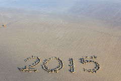 Year 2015 number written on sandy beach. Royalty Free Stock Photos