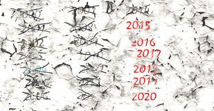 Year numbers 2000 until 2020 on peeling off plaster Stock Images