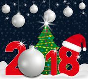 2018 year numbers with Christmas Tree and silver ball and Santa hat on a dark blue background with snow falling. New year and Chri Stock Photography