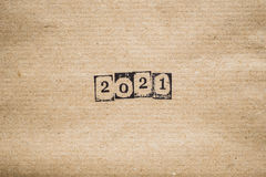 The year 2021 on plain paper. The year 2021 in numbers on plain textured paper royalty free stock photos