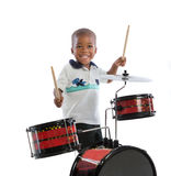 3 Year Old African American Boy Playing Drum Set Isolated Stock Photography