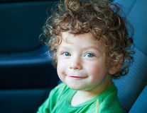 1 year old baby boy portrait. Portrait of 1 year old baby boy in the car Royalty Free Stock Image