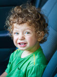 1 year old baby boy portrait. Portrait of 1 year old baby boy in the car Stock Photos