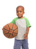 2 year old baby boy standing holding a basket ball Stock Photography