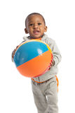 1 year old baby boy standing holding a beach ball Royalty Free Stock Photos