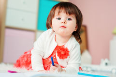 1 year old baby girl drawing with pencils at home Royalty Free Stock Photography