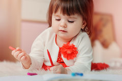 1 year old baby girl drawing with pencils at home Stock Photography
