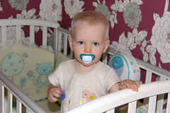 Year old boy in the bedroom. Year old baby boy in the bedroom royalty free stock photo