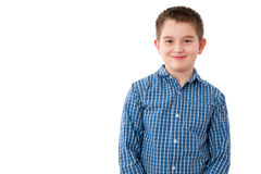 10 Year Old Boy with Mischievous Smile on White. Portrait of a Cute 10 Year Old Boy with a Mischievous Sweet Smile, Standing Against White Background with Copy Royalty Free Stock Images