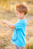 5 year old boy outdoor Stock Image