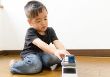 2-year-old boy playing with toy car Stock Image