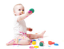 Year-old child with paint. Year-old child playing with paints Royalty Free Stock Photos
