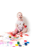Year-old child with paint. Year-old child playing with paints Royalty Free Stock Photo