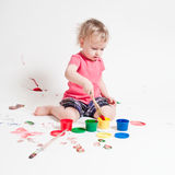 Year-old child with paint. Year-old child playing with paints Stock Photo