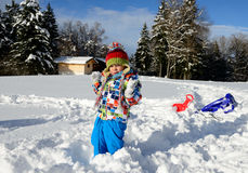3 year old child playing in the snow Royalty Free Stock Photography