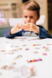 2 year old child solving jigsaw puzzle Stock Photo