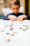 2 year old child solving jigsaw puzzle Stock Photos