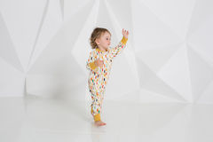 Year-old child standing near white wall in studio Royalty Free Stock Images