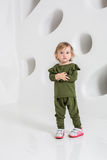 Year-old child standing near white wall in studio Stock Images