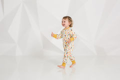 Year-old child standing near white wall in studio Royalty Free Stock Photo