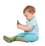 Year-old child using mobile Stock Photo