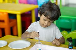 3 year old children in Asia are conducting scientific experiments. For education stock photo