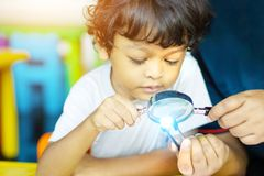 3 year old children in Asia are conducting scientific experiments. For education stock photos