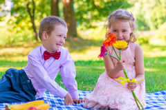 6 year old children on a date in the park Stock Photos