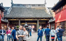 At the 600-year-old Old City God Temple, Shanghai, China. Shanghai, China - Nov 6, 2016: Gate to the 600-year-old Old City God Temple. Visitors frequent this stock photos