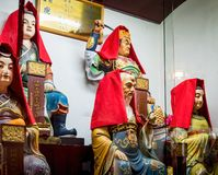 At the 600-year-old Old City God Temple, Shanghai, China. Shanghai, China - Nov 6, 2016: Inside the 600-year-old Old City God Temple. A few rare figurines of stock photo