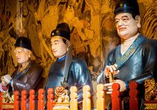 At the 600-year-old Old City God Temple, Shanghai, China. Shanghai, China - Nov 6, 2016: Inside the 600-year-old Old City God Temple. Statues of huge Taoist royalty free stock photo