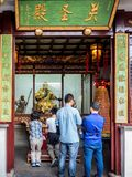 At the 600-year-old Old City God Temple, Shanghai, China. Shanghai, China - Nov 6, 2016: In the 600-year-old Old City God Temple. Patrons waiting in turn to royalty free stock images
