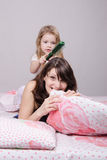Year old daughter combed hair mom Royalty Free Stock Images