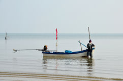 40 year old Fisherman prepare boat for fishing in Andaman Sea Royalty Free Stock Images