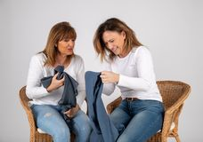 50 year old friends laugh together stock photos