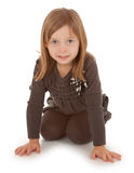 3 Year Old Girl Crawling and Smiling at the Camera Stock Image