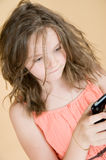 8 year old girl with a mobile phone. Royalty Free Stock Photography