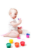 Year-old girl with paint. Year-old girl playing with paints Royalty Free Stock Photo