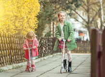 Year-old girl riding her scooter Royalty Free Stock Photos