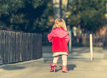 Year-old girl riding her scooter Royalty Free Stock Photo