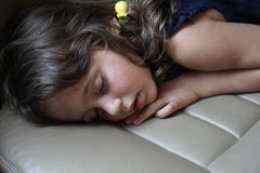 3-4 year old girl sleeps in the back seat of the car royalty free stock photography