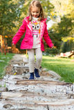 4 year old girl walking over pebbles Royalty Free Stock Photography