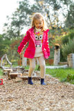 4 year old girl walking over pebbles Stock Images
