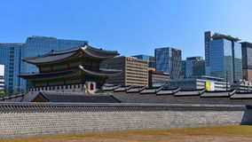 600-year old Gyeongbokgung Palace next to modern office buildings in Seoul Stock Image