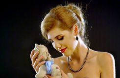 18 year old holiday holding bear vintage toys. Royalty Free Stock Photography