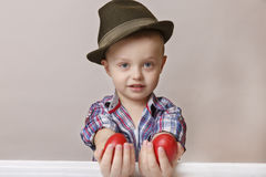 4 year old little and cute boy in a hat and shirt holding hands Stock Photos