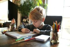 Young School Aged Child Working on Coloring Art Project Stock Photos