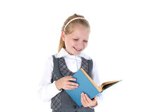 8 year old school girl with book Royalty Free Stock Photos