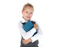 8 year old school girl with book smiling Royalty Free Stock Photo